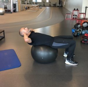 Exercises for a Stronger Core - Stability Ball Crunches Step 1
