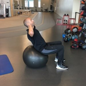 Exercises for a Stronger Core - Stability Ball Crunches Step 2